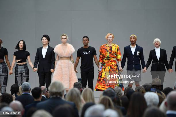 Lang Lang Cara Delevingne Lil Buck Robert Carsen Tilda Swinton Pharell Williams and Helen Mirren pose on stage during the Karl Lagerfeld Homage at...