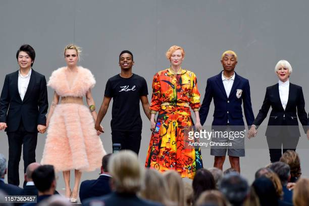 Lang Lang Cara Delevingne Lil Buck Tilda Swinton Pharrell Williams and Helen Mirren pose on stage during the Karl Lagerfeld Homage at Grand Palais on...