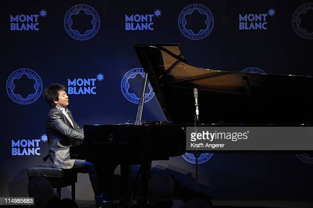 Lang Lang chairman of the Montblanc Cultural Foundation plays piano during the Montblanc De La Culture Arts Patronage Award 2011 at the...