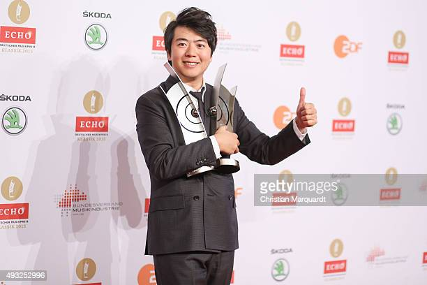 Lang Lang poses with his Instrumentalist of the Year/Piano award and special award for the Lang Lang International Music Foundation honored at the...