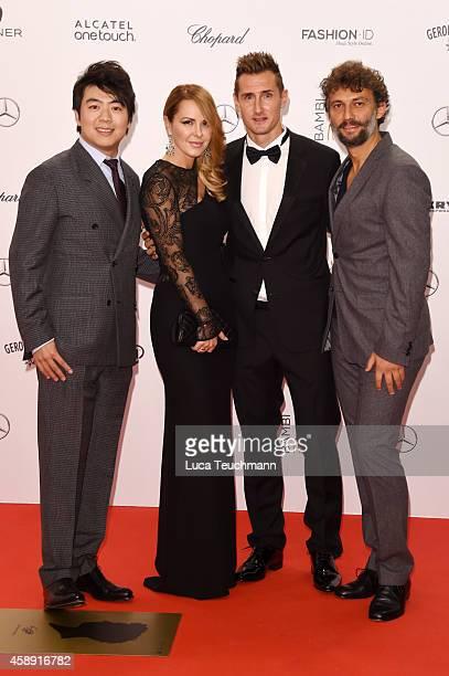 Lang Lang Sylwia Klose Miroslav Klose and Jonas Kaufmann attend Kryolan at the Bambi Awards 2014 on November 13 2014 in Berlin Germany