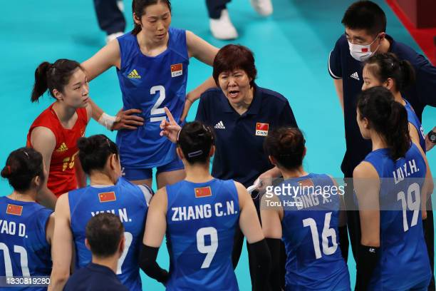 Lang Ping of Team China speaks in the huddle prior to the match against Team United States during the Women's Preliminary - Pool B volleyball on day...