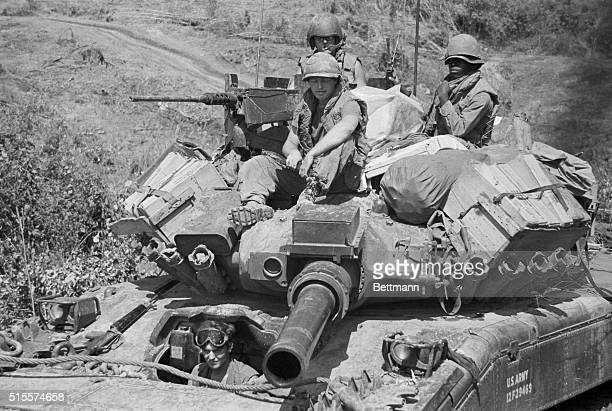 An American tank crew covers the advance of fresh South Vietnamese troops pushing into Laos Feb 28 The tanks were positioned on the border until the...