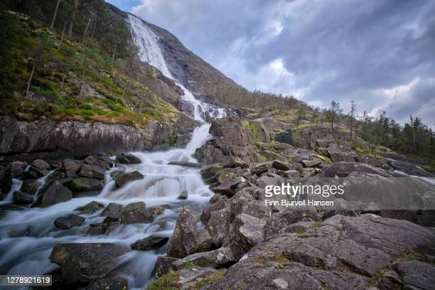 langfossen waterfall in åkrafjord norway - finn bjurvoll stock pictures, royalty-free photos & images