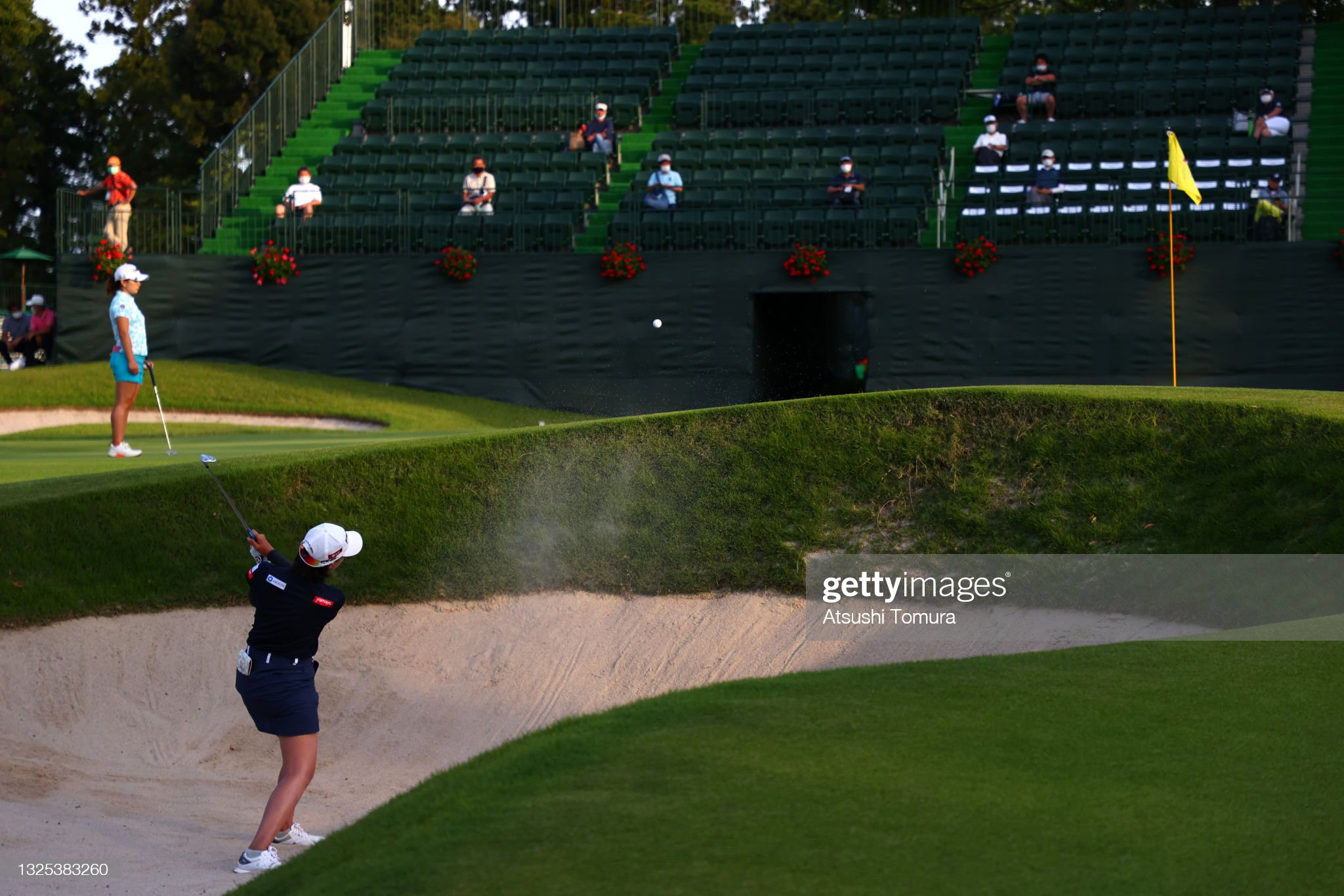 https://media.gettyimages.com/photos/langkul-of-thailand-hits-out-from-a-bunker-on-the-18th-hole-during-picture-id1325383260?s=2048x2048