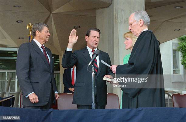 President Reagan watches former FBI Director Webster is sworn in as the new Director of the CIA Administering the oath is Supreme Court Justice Lewis...