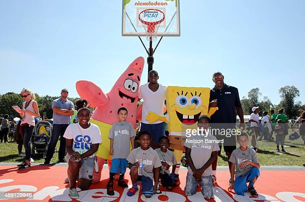 Langston Galloway and Tiny Archibald attend Nickelodeon's 12th Annual Worldwide Day of Play at Prospect Park on September 19 2015 in New York City