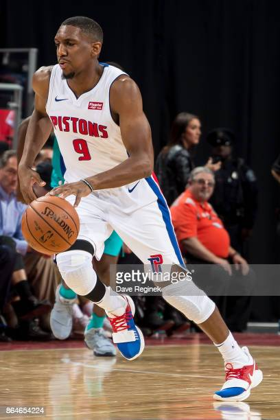 Langston Galloway of the Detroit Pistons controls the ball against the Charlotte Hornets during the Inaugural NBA game at the new Little Caesars...