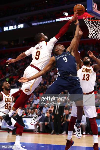 Langston Galloway of the Detroit Pistons drives to the basket past Dwyane Wade and Tristan Thompson of the Cleveland Cavaliers during the second half...