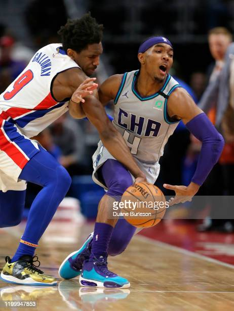 Langston Galloway of the Detroit Pistons fouls Devonte' Graham of the Charlotte Hornets while chasing a loose ball during the second half at Little...