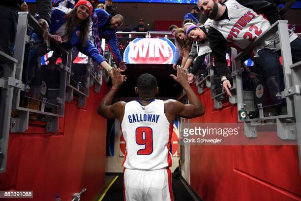 Langston Galloway of the Detroit Pistons high five fans after the game against the Phoenix Suns on November 29 2017 at Little Caesars Arena in...