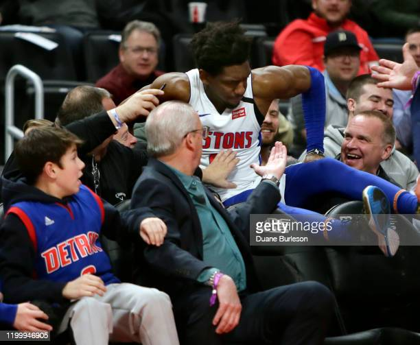 Langston Galloway of the Detroit Pistons is helped out of the stands after diving for a loose ball against the Charlotte Hornets during the first...