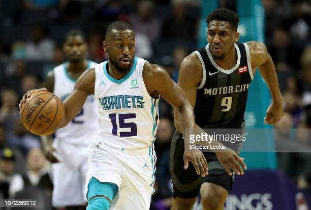 Langston Galloway of the Detroit Pistons watches as Kemba Walker of the Charlotte Hornets brings the ball up the court during their game at Spectrum...