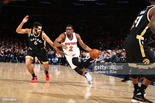 Langston Galloway of the New York Knicks drives to the basket against Cory Joseph of the Toronto Raptors on April 10 2016 at Madison Square Garden in...