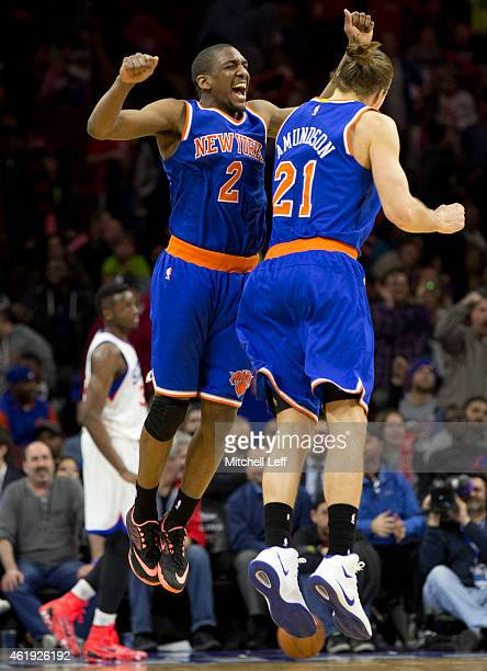 Langston Galloway of the New York Knicks reacts with Lou Amundson after making a three point basket in the closing seconds of the game against the...