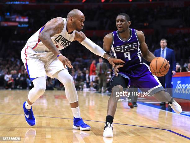 Langston Galloway of the Sacramento Kings dribbles as he is guarded by Marreese Speights of the LA Clippers during a 11595 Clipper win at Staples...