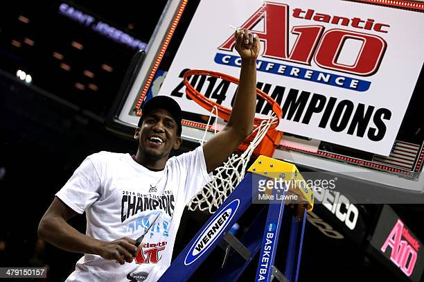 Langston Galloway of the Saint Joseph's Hawks cuts down the net after defeating the Virginia Commonwealth Rams during the Championship game of the...