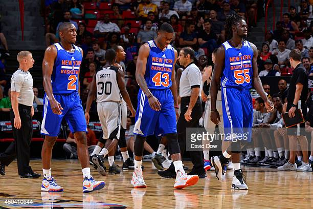 Langston Galloway Thanasis Antetokounmpo and Maurice Ndour of the New York Knicks walk toward the bench during the game against the San Antonio Spurs...