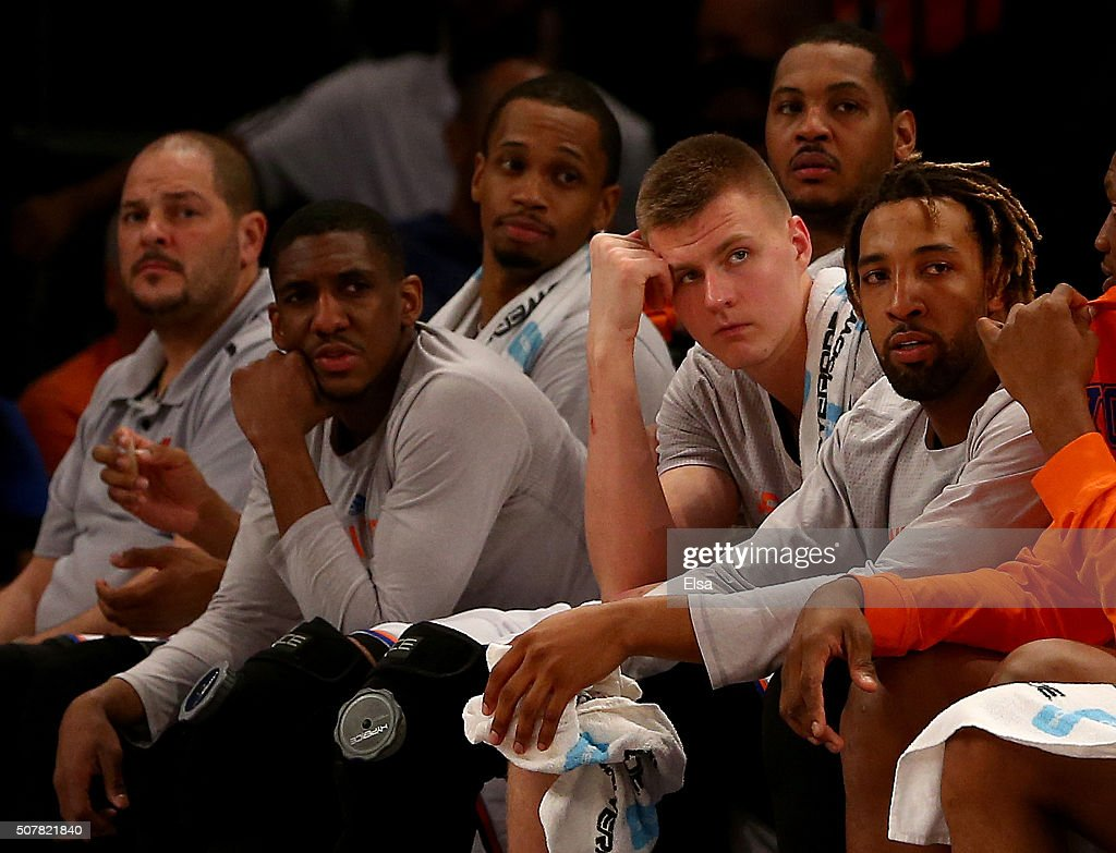 Langston Galloway #2,Lance Thomas #42,Carmelo Anthony #7,Kristaps Porzingis #6 and Derrick Williams #23 of the New York Knicks react on the bench in the final minutes of the game against the Golden State Warriors at Madison Square Garden on January 31, 2016 in New York City.The Golden State Warriors defeated the New York Knicks 116-95.