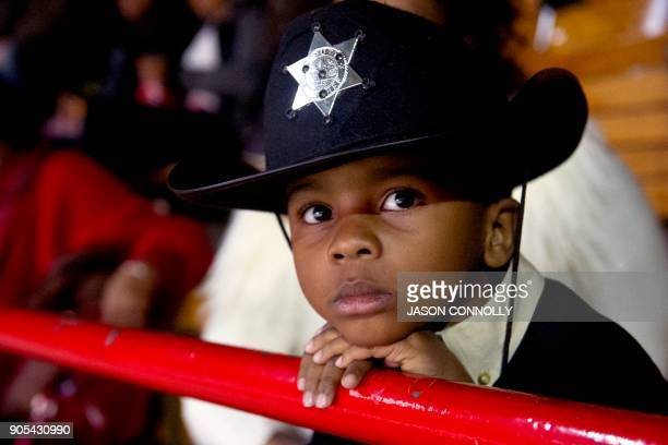 Langston Hendley of Aurora Coloradodressed in his sheriff's hat watches the MLK Jr African American Heritage Rodeo at the National Western Stock Show...