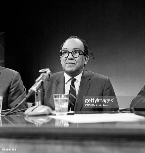 Langston Hughes, poet and columnist for The New York Post newspaper , asks questions of the panel on the civic and current affairs television...