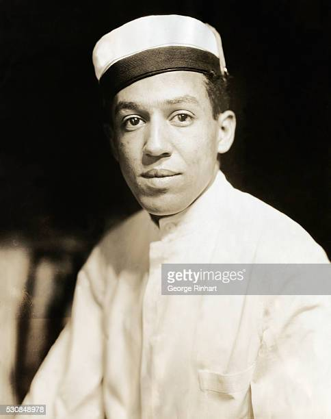 Langston Hughes wears a busboy uniform. The African American writer took these jobs and waited on tables to support himself.