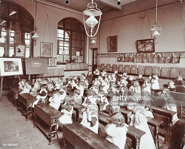 Language teaching stage 1 Hugh Myddelton School Finsbury London 1906 A class of young children sitting at their desks in a classroom all with their...