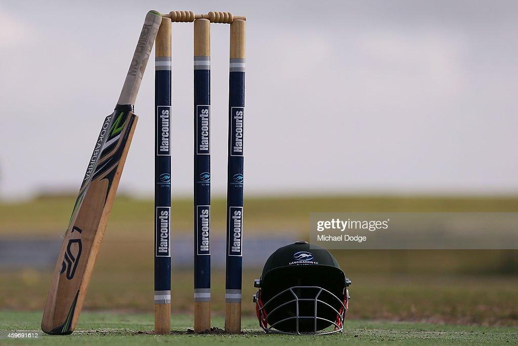 A Langwarrin club cricket bat rests on stumps at Lloyd Park before an U/12 match between Langwarrin and Somerville at Lloyd Park on November 29, 2014 in Melbourne, Australia. Domestic cricket competition resumed today around Australia for the first time following the death of cricketer Phillip Hughes in Sydney on Thursday.