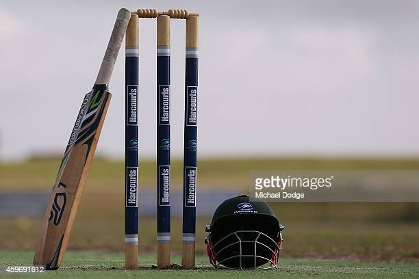 Langwarrin club cricket bat rests on stumps at Lloyd Park before an U/12 match between Langwarrin and Somerville at Lloyd Park on November 29 2014 in...