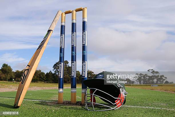 Langwarrin club cricket bat rests on stumps at Lloyd Park before an U/12 match between Langwarrin and Somerville at Lloyd Park on November 29 2014 in...