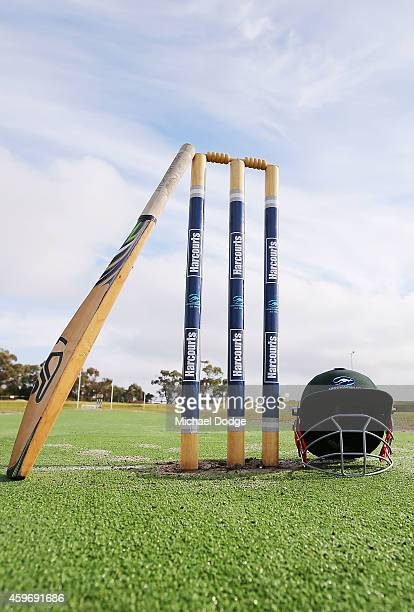 Langwarrin club cricket bat rests on stumps in respect for Phillip Hughes at Lloyd Park before an U/12 match between Langwarrin and Somerville at...