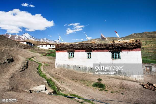 langza himalayan village with snowcapped peak backdrop - langsa stock photos and pictures