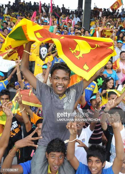 Lankan cricket fans cheer in support of their national team during the Cricket World Cup semifinal match between Sri Lanka and New Zealand at the R...