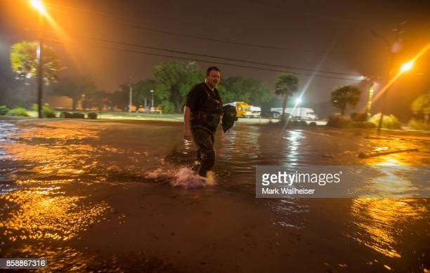Lanny Dean from Tulsa Oklahoma takes video as he wades along a flooded Beach Boulevard next to Harrahs Casino as the eye of Hurricane Nate pushes...
