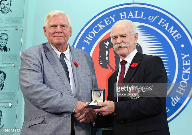 Lanny McDonald Chairman of the Hockey Hall of Fame presents Bill Hay with his Hall of Fame ring at a photo op at the Hockey Hall of Fame and Museum...