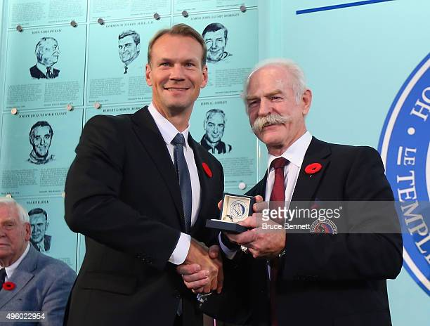 Lanny McDonald Chairman of the Hockey Hall of Fame presents Nicklas Lidstrom with his Hall of Fame ring at a photo op at the Hockey Hall of Fame and...