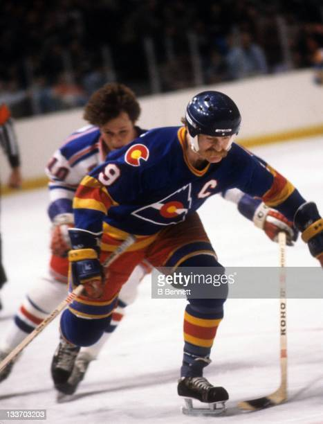 Lanny McDonald of the Colorado Rockies skates up the ice as Ron Duguay of the New York Rangers follows behind during their game on March 11 1981 at...