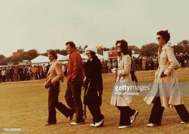 Lanny Wadkins and Ray and Maria Floyd walk down the fairway during the Ryder Cup