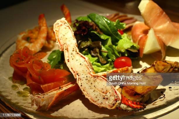 Lan's Combination Platter - Prawns w/Manago Salsa, Marinated Salmon w/Lime Honey Dressing, Alaska Crad Legs Flovored w/Crushed Block Pappercorn,...