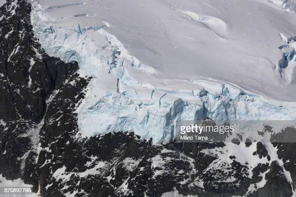 Lans ice stands atop a ridge as seen from NASA's Operation IceBridge research aircraft in the Antarctic Peninsula region on October 31 above...