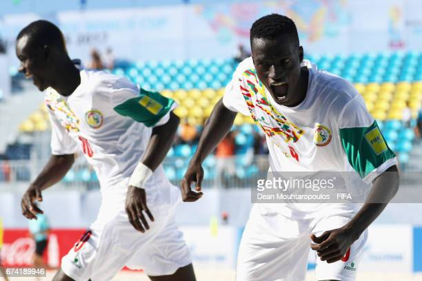 Lansana Diassy of Senegal celebrates scoring a goal with team mates Mamour Diagne during the FIFA Beach Soccer World Cup Bahamas 2017 group A match...