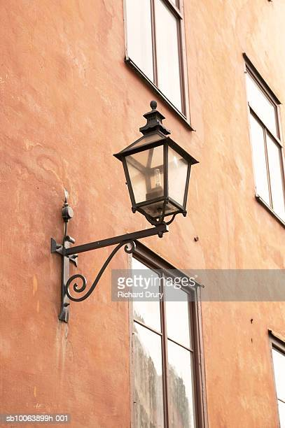 lanter on building wall, low angle view - richard drury stock pictures, royalty-free photos & images