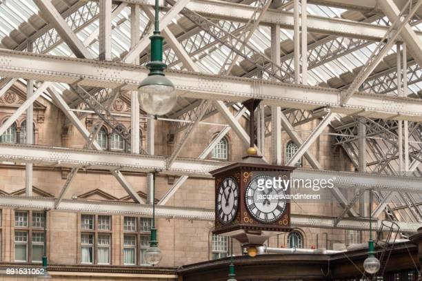 lantern and clock in the central railway station, glasgow, scotland - old glasgow stock photos and pictures