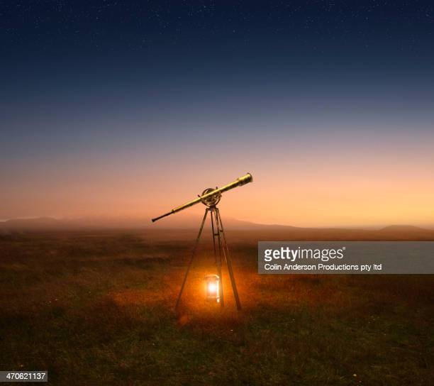 Lantern and telescope in rural field