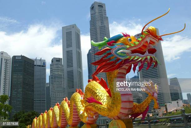 A lantern dragon adorn the highrise building of the Singapore's financial district to mark the Chinese midautumn lantern festival 23 September 2004...