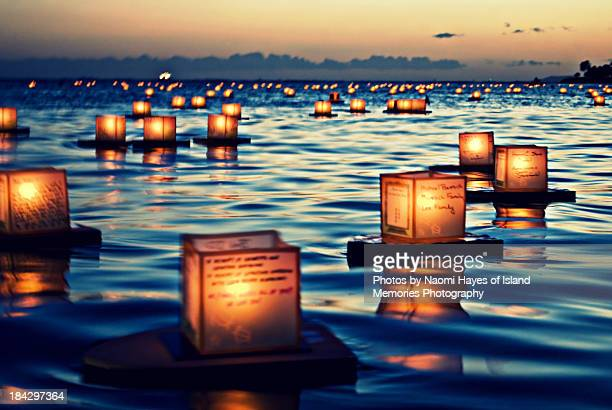2011 lantern floating ceremony hawaii - lantern stock photos and pictures