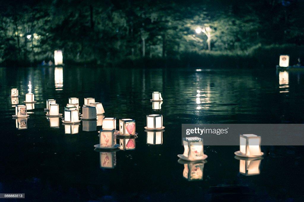 Lantern floating on the night lake : Stock Photo