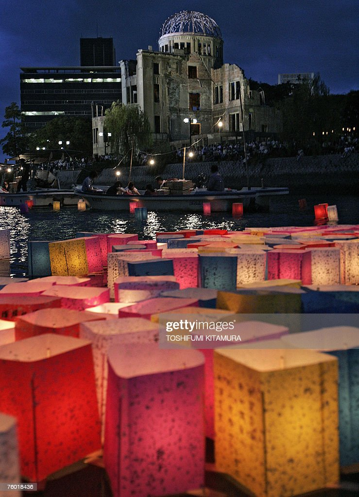 Lantern floats are seen floating down the Motoyasu river beside the Atomic Bomb Dome, 06 August 2007 to mourn victims of the atomic bombing of Hiroshima in 1945. Japan vowed never to seek atomic weapons and urged nuclear powers to give up their own arsenals 62 years after the world's first nuclear attack on Hiroshima. Some 45,000 people recited silent prayers at 8:15 am, the exact moment in 1945 when a single US bomb instantly killed more than 140,000 people and fatally injured tens of thousands of others with radiation or horrific burns.