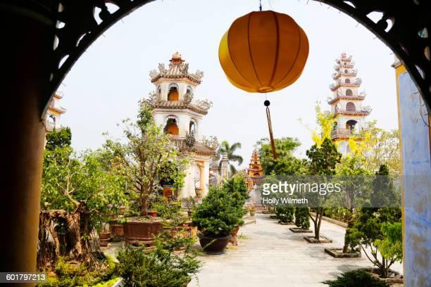 Lantern hanging in archway over Hanoi garden, Hanoi Capital Region, Vietnam