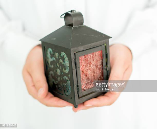 lantern in hands - hari raya stock pictures, royalty-free photos & images